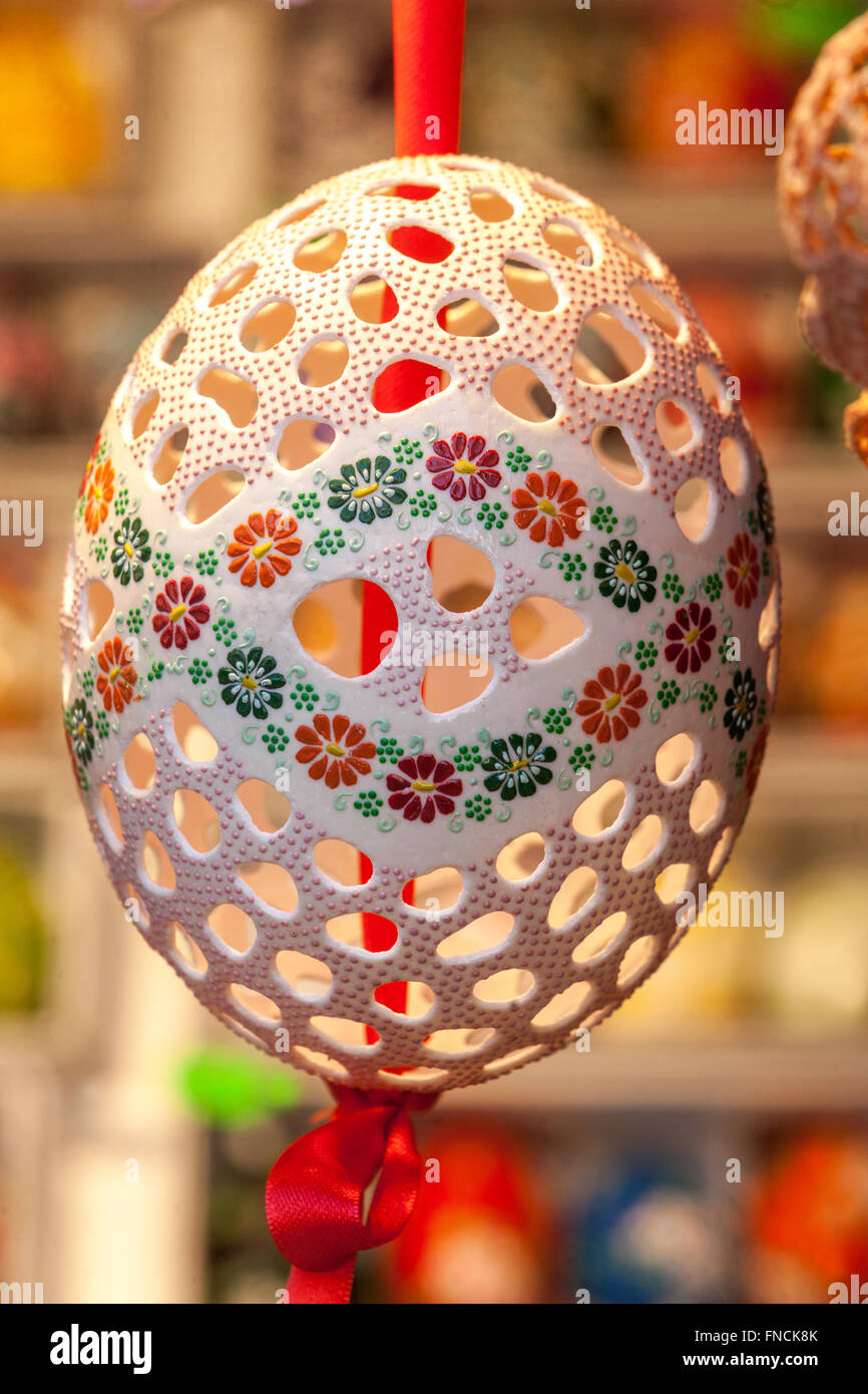 Carved perforated Easter Ostrich eggs Easter market in Prague, Czech Republic - Stock Image
