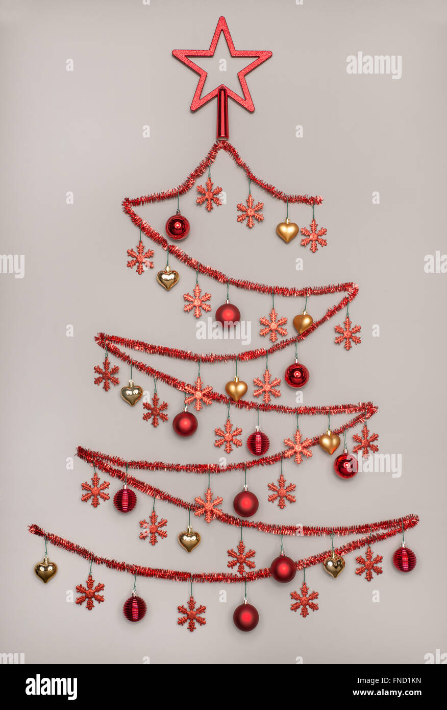 handmad tinsel christmas tree with star shape hanging baubles with snowflake , Creativity Concepts - Stock Image