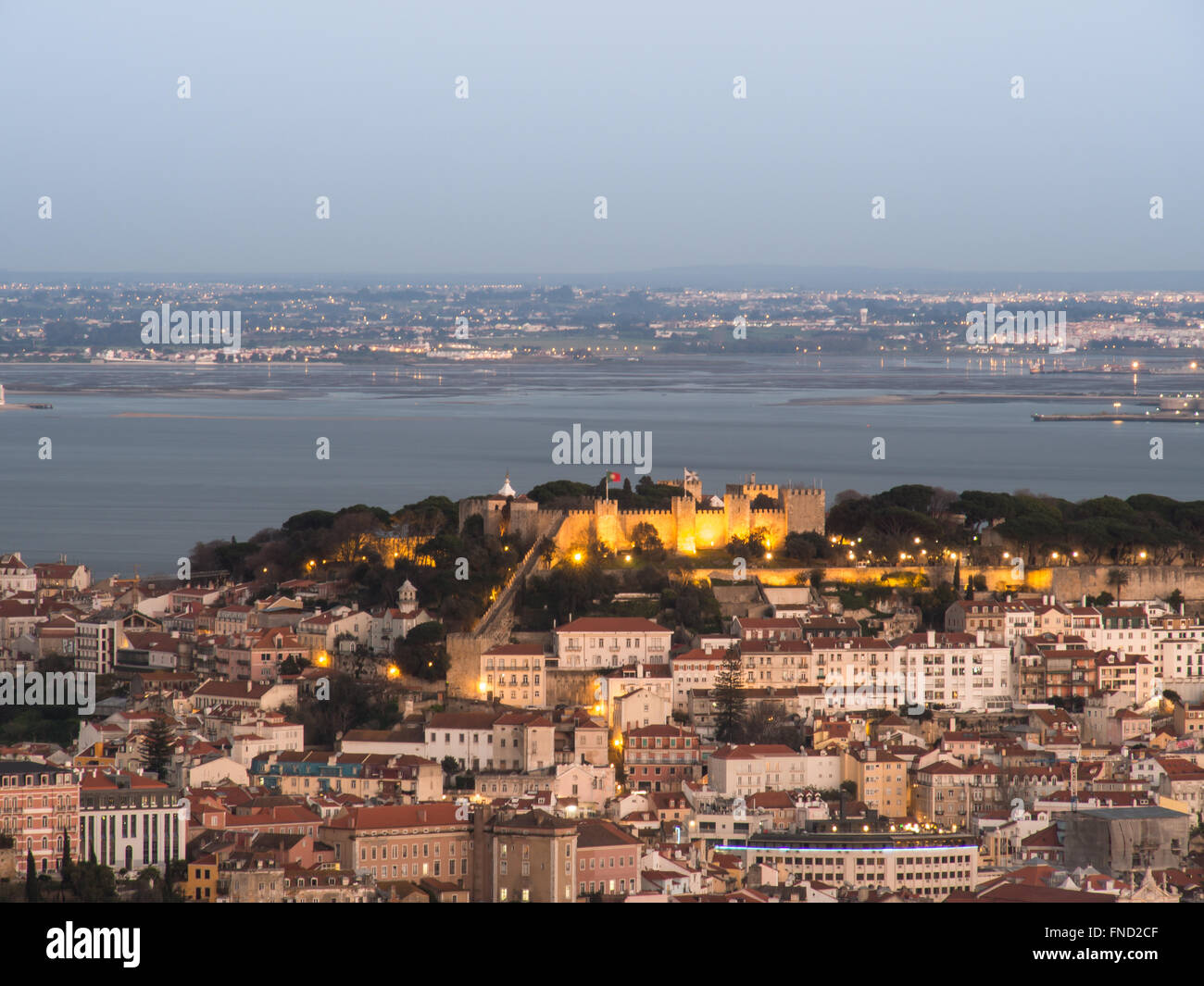 View of the city of Lisbon. Sao Jorge Castle and Alfama and Tagus River - Stock Image