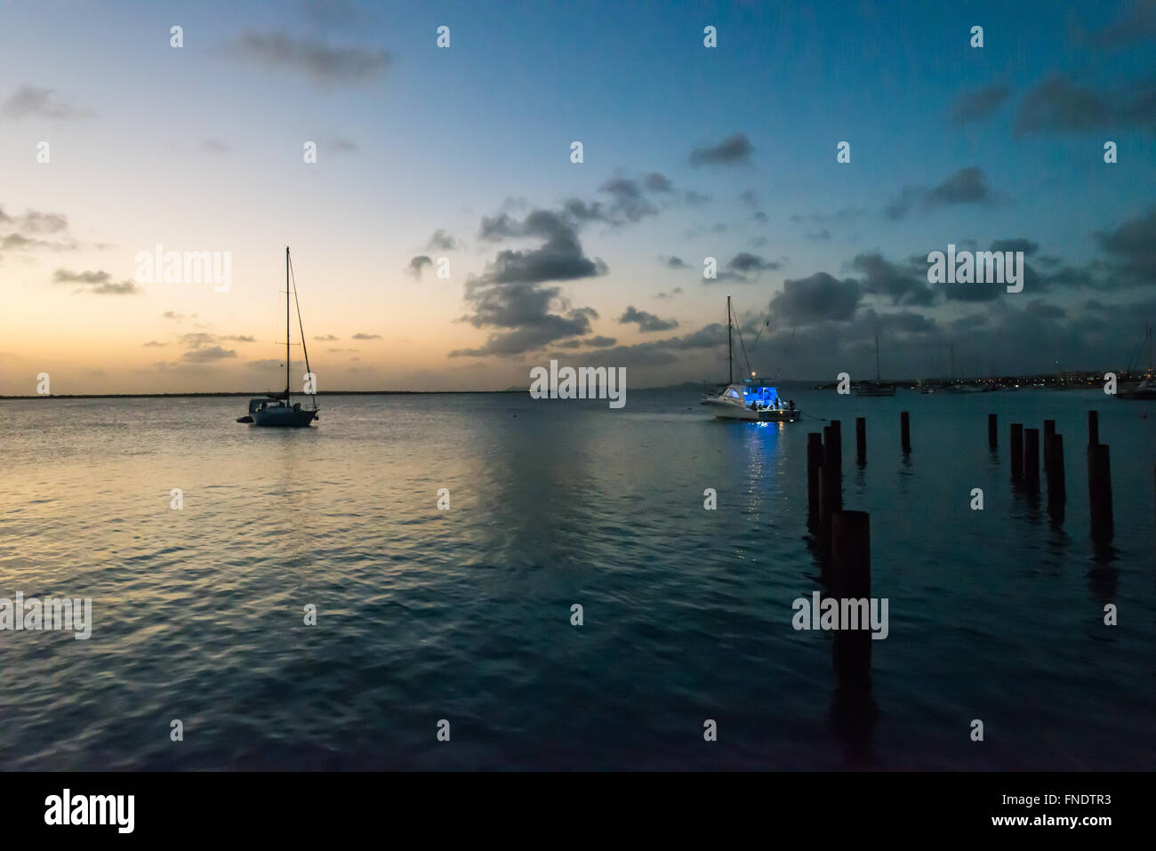 Beautiful sailing ships in the evening near the Kralendijk capital city of Bonaire - Stock Image