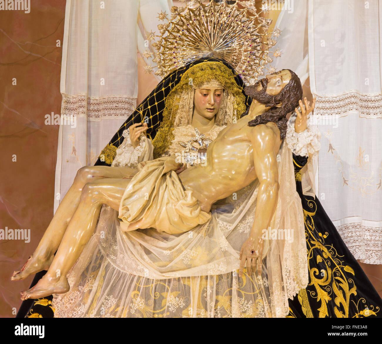 CORDOBA, SPAIN - MAY 26, 2015: The traditional vested Lady of Sorrow statue (Pieta) in church Iglesia de San Augustin, Stock Photo
