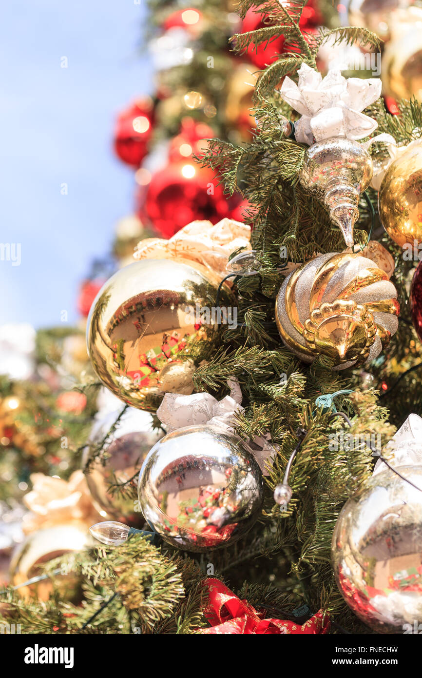 Red Green Gold Silver Christmas Ornaments Hanging On A Christmas