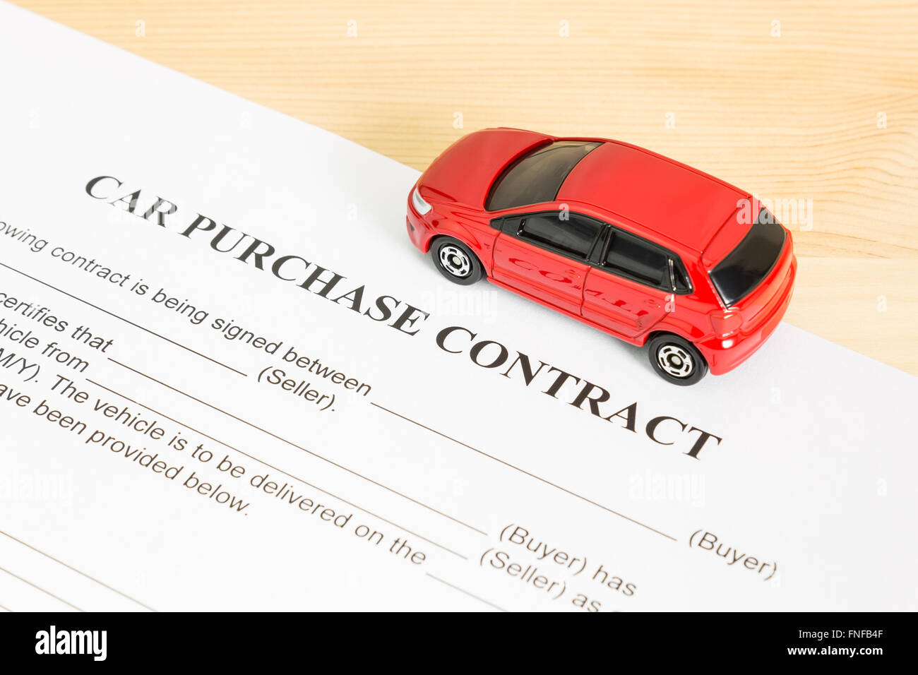 car purchase contract with red car on right view auto purchase