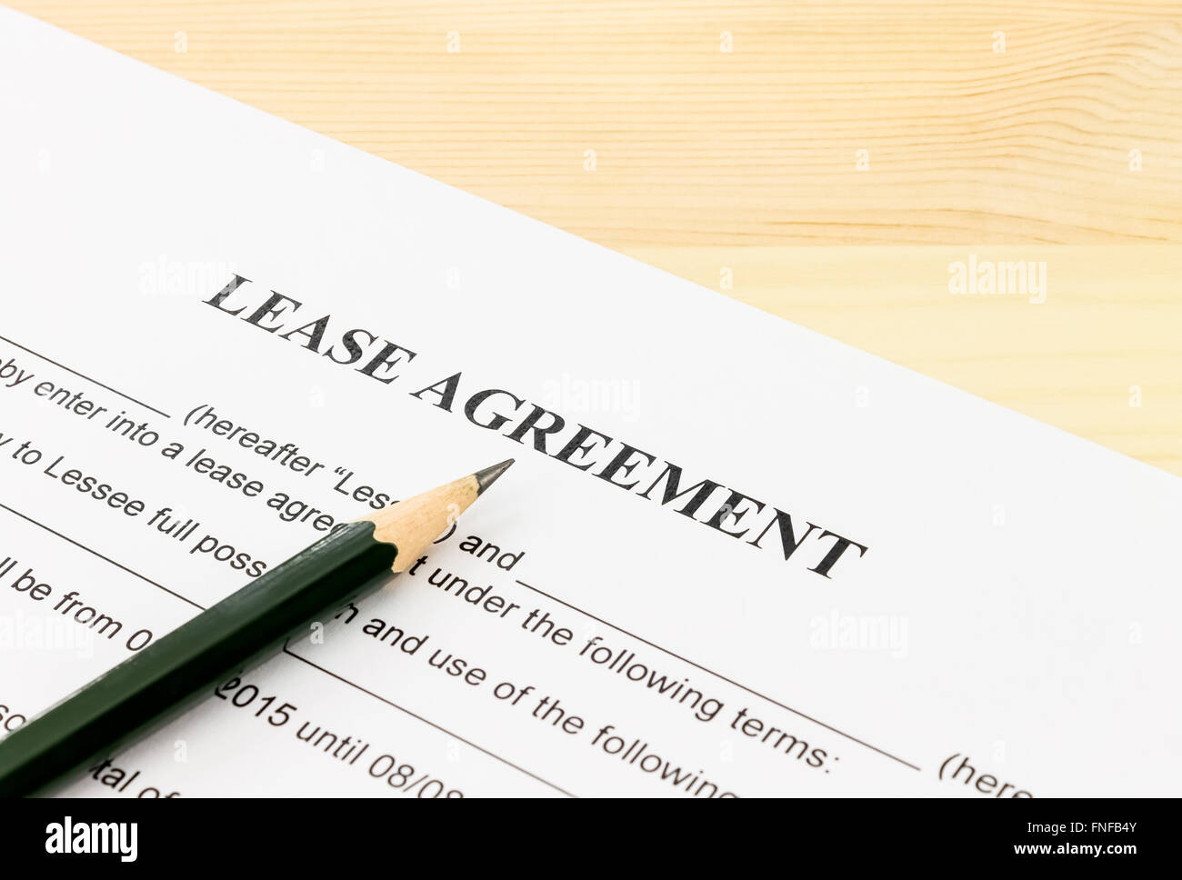 Lease Agreement Contract Document And Pencil Bottom Left Corner On