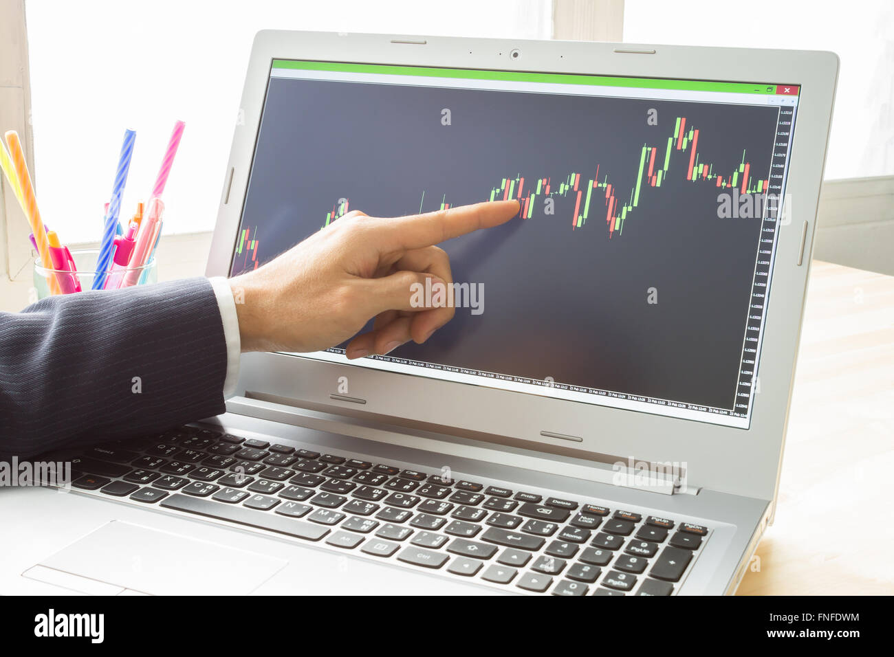 Businessman is pointing stock graph or Forex graph . Technical analysis forex or stock by professional trader - Stock Image