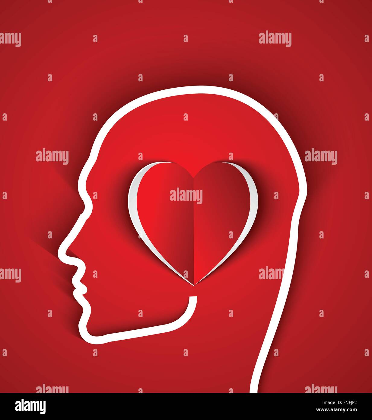Human outline head with paper red heart on red background .The person in love concept - Stock Image