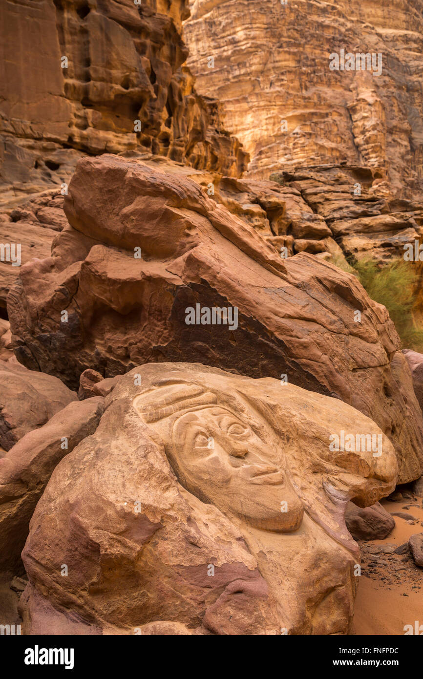 Petroglyphs in the rock in the Wadi Rum desert of southern Hashemite Kingdom of Jordan, Middle East. - Stock Image