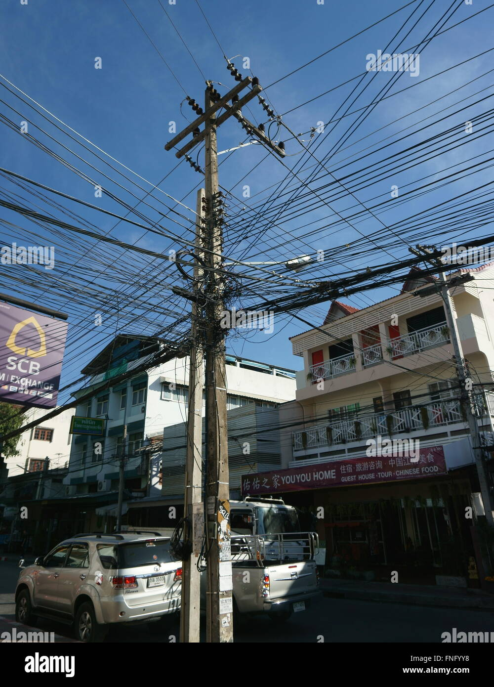 messy overhead electricity cables  in Chiang Mai, Thailand - Stock Image
