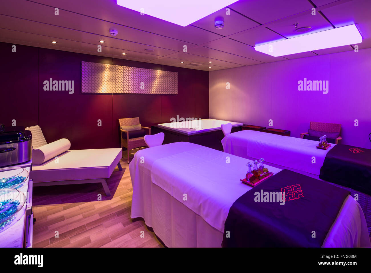 Treatment room with colour changing lighting. Norwegian Cruise Ship – The Escape, Southampton, United Kingdom. Architect: - Stock Image