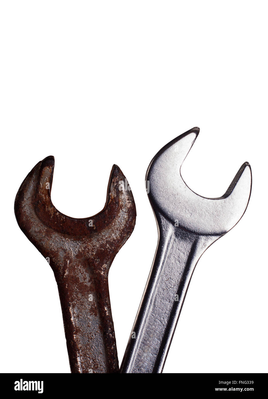 Two wrenches one rusted, one new on top of each other - Stock Image