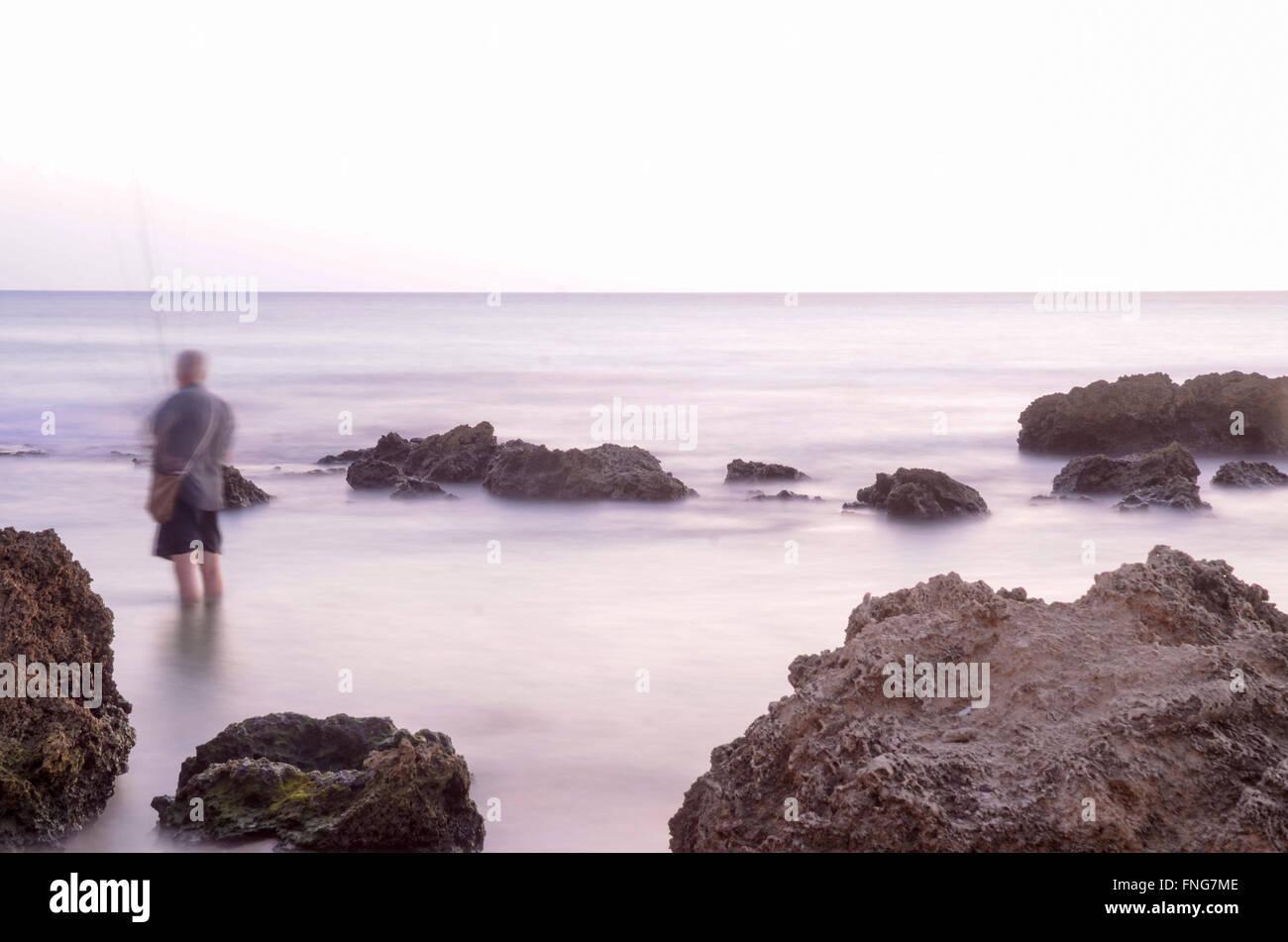Lone Fisherman in the Mediterranean sea - Stock Image