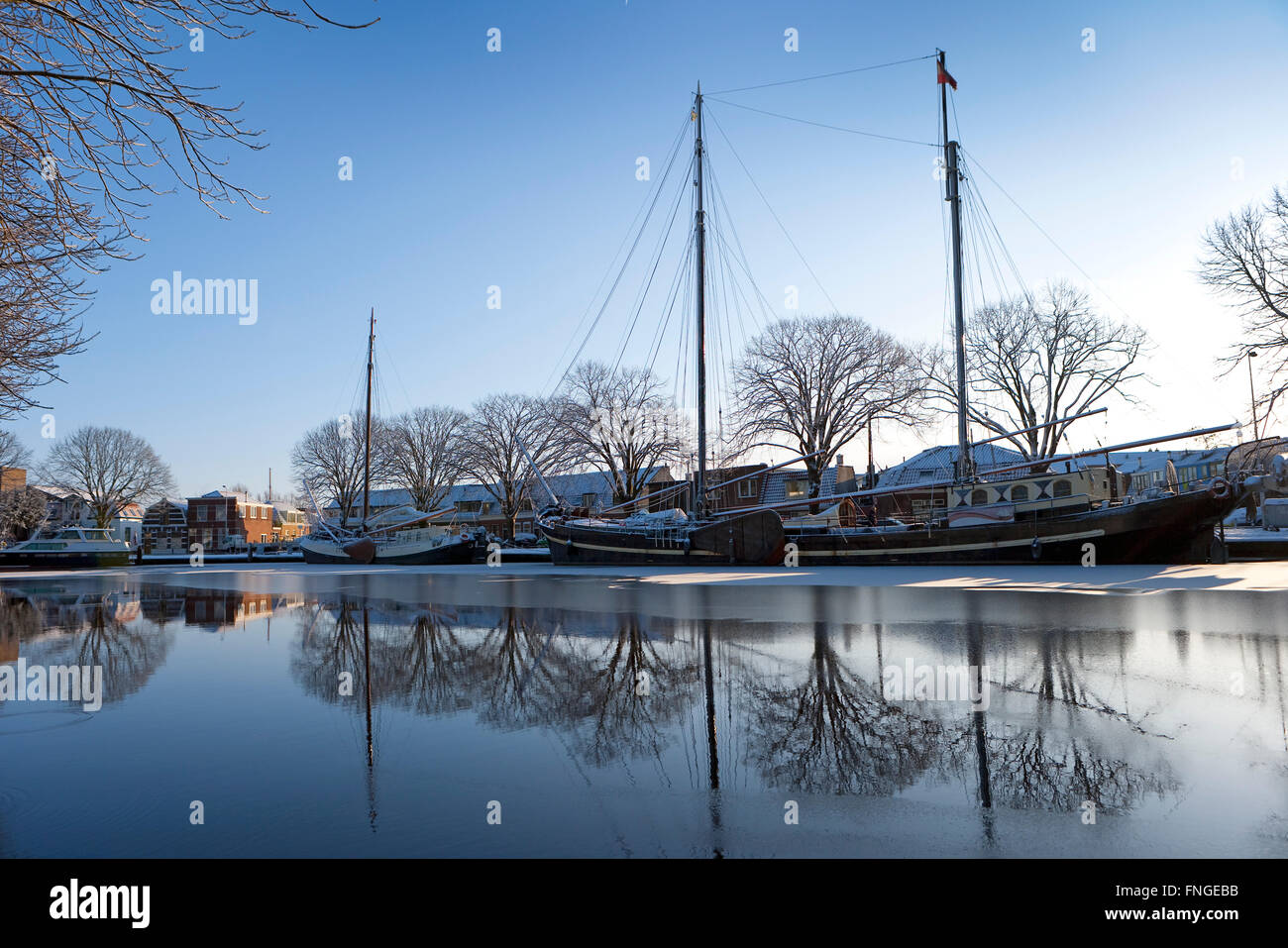 Dutch classic ships in the canal in Leiden in wintertime - Stock Image