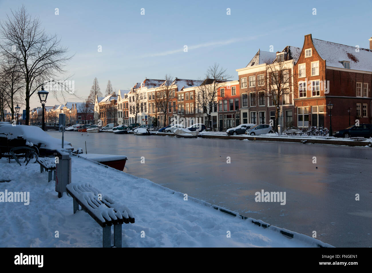 Frozen canal in winter in Leiden, Holland - Stock Image