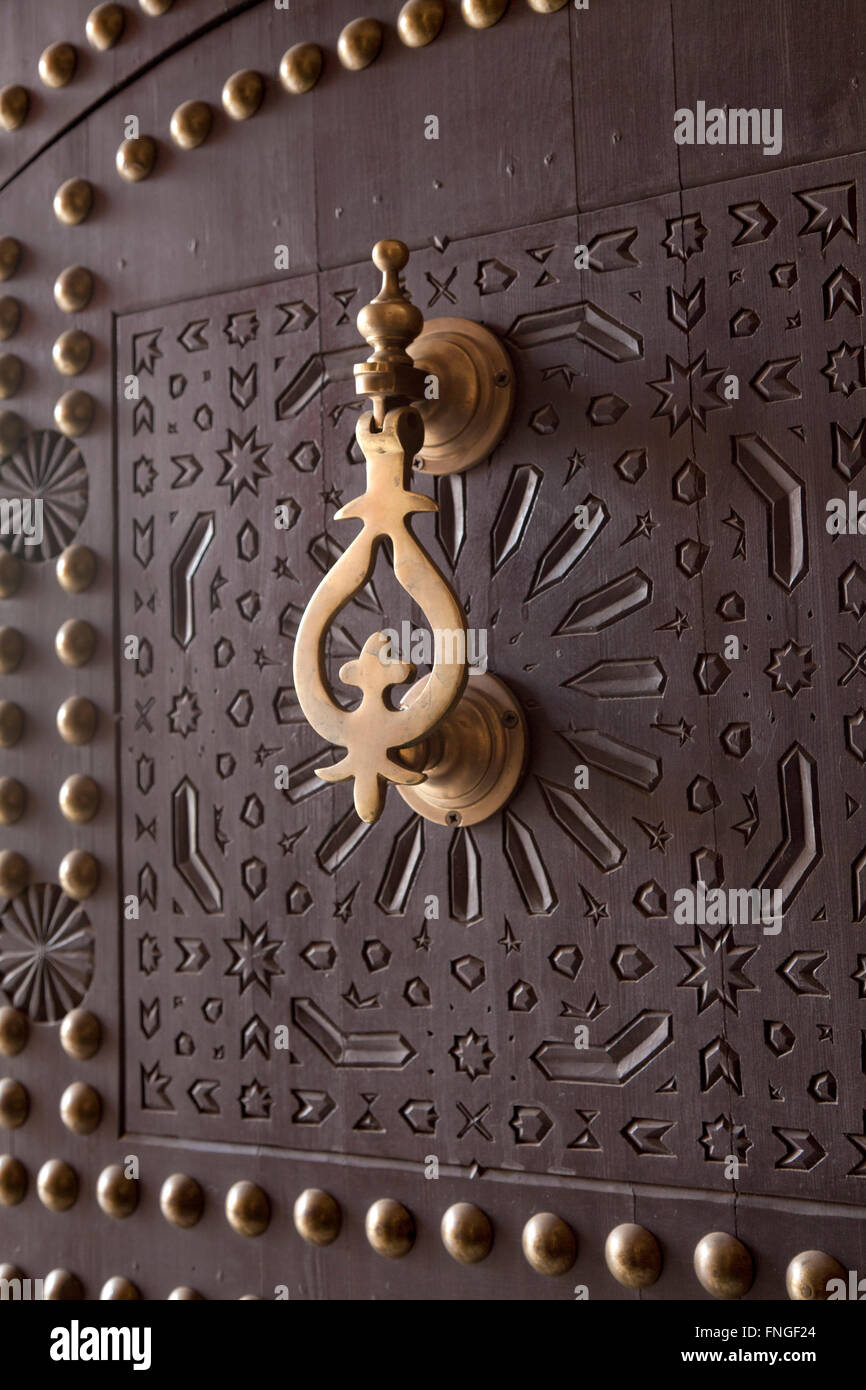 Metal doorknocker on wooden door Marrakech, Morocco Stock Photo