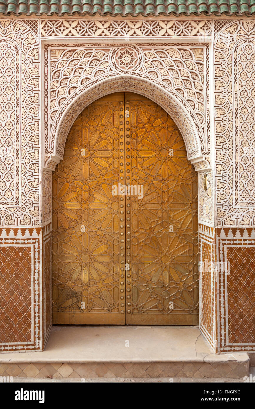 Brass decorated Moroccan door in Marrakesh, Morocco - Stock Image