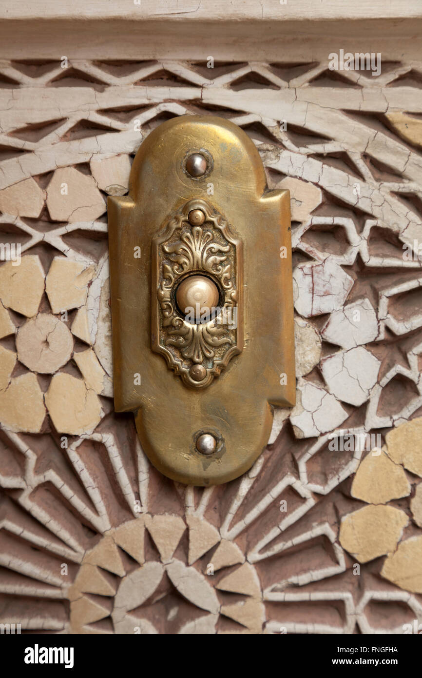 Brass Moroccan door bell in marrakesh, Morocco - Stock Image