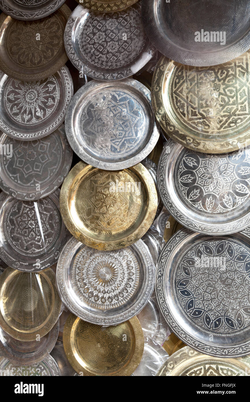 Moroccon metal  trays for sale in the souk of Marrakesh, Morocco Stock Photo