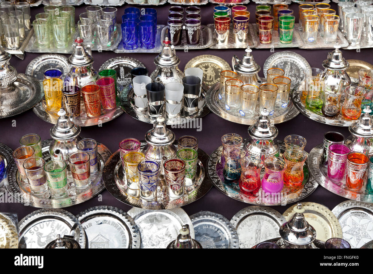 Moroccan glassware and teapots  for sale in the souk of Marrakesh, Morocco - Stock Image