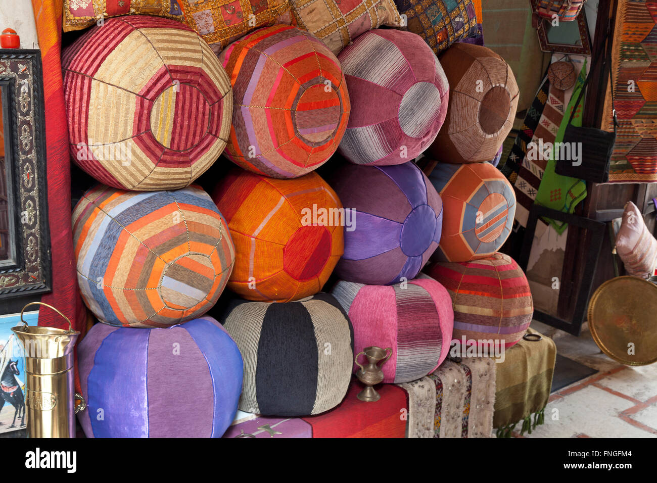 Moroccan poufs for sale in the souk of Marakesh, Morocco - Stock Image