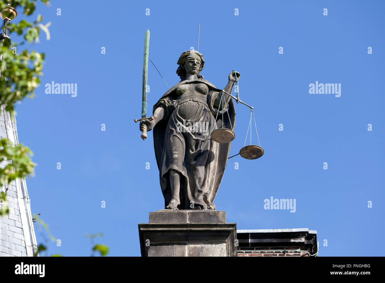 Old statue of Lady Justice on the Gravensteen in Leiden, Holland - Stock Image