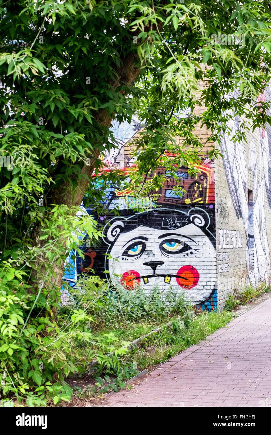 Street art and graffiti on derelict building on Riverside walk along Pank River between Gerichtstrasse & Pankstrasse, - Stock Image