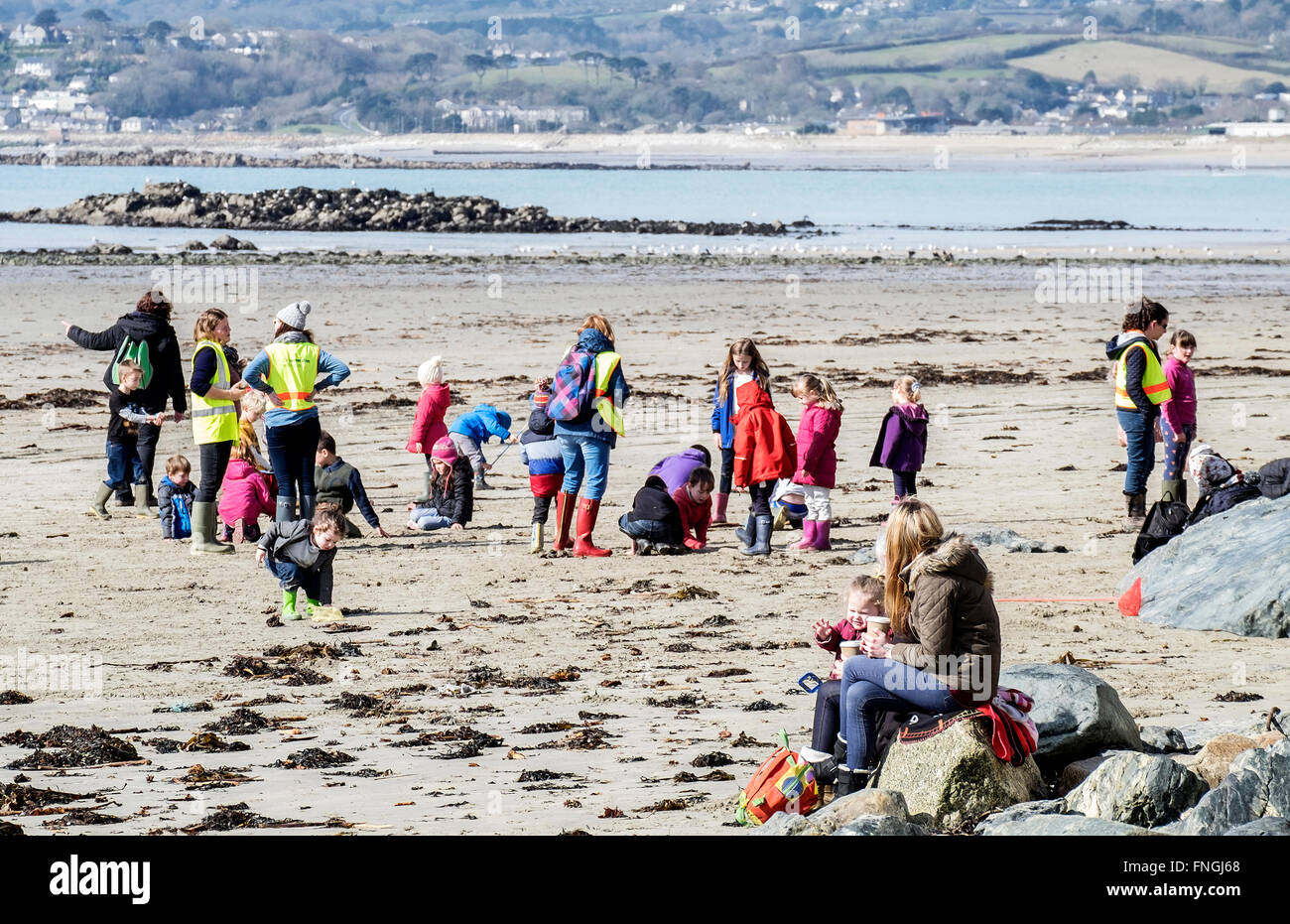 A primary school having lessons on the beach at Marazion in Cornwall, UK - Stock Image