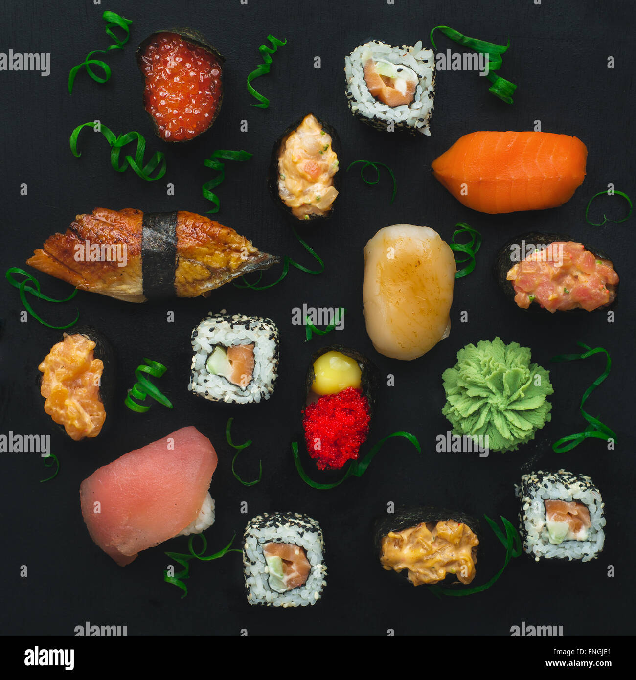 Sushi pattern on a dark background - Stock Image