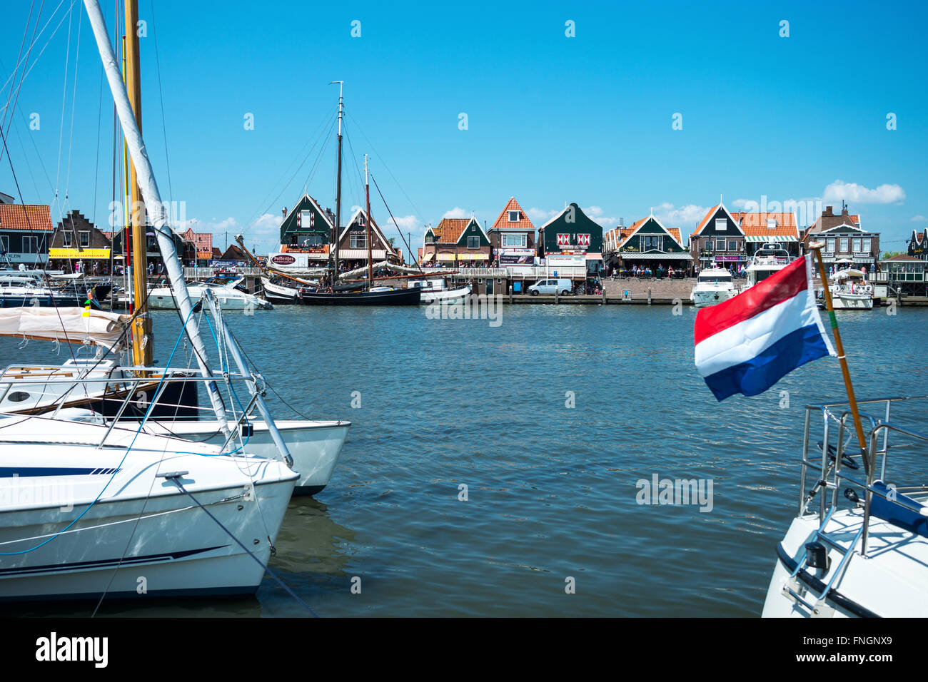 Amsterdam, Waterland district, Volendam, boats in the harbour in front of the town center Stock Photo