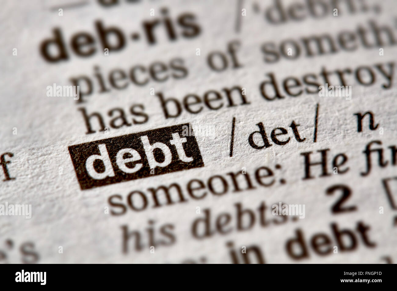 Debt Word Definition Text in Dictionary Page - Stock Image