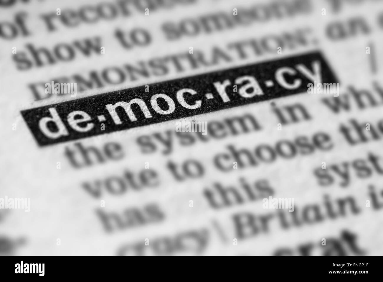 Democracy Word Text in Dictionary Page - Stock Image