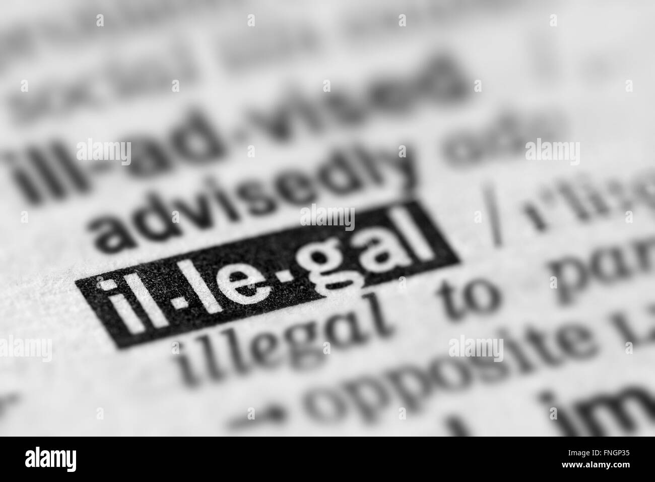 Illegal Definition Word Text in Dictionary Page - Stock Image