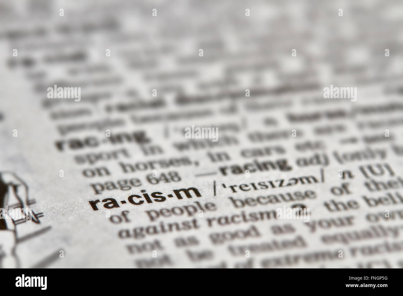 Racism Word Definition Text in Dictionary Page - Stock Image