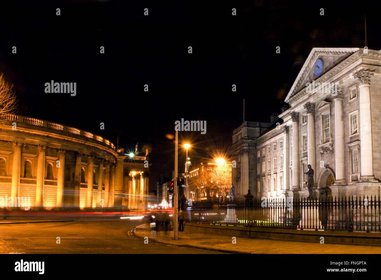 Slow shutter car light trails at night outside Trinity College Dublin and Central Bank - Stock Image