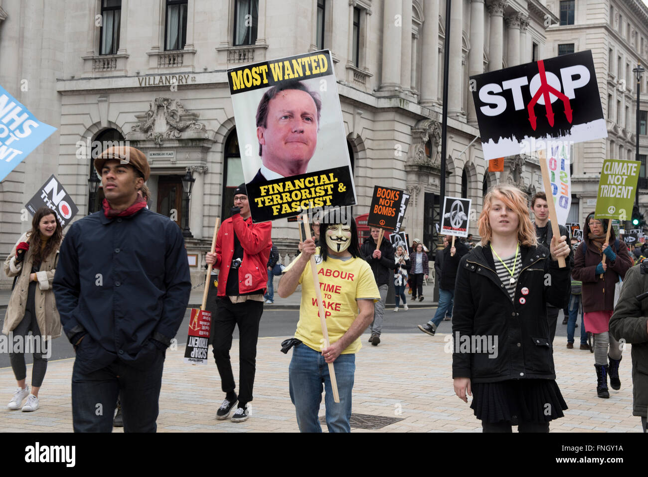 Young anti-nuclear protesters marching towards the Trafalgar Square to protest against the renewal of Trident Nuclear - Stock Image