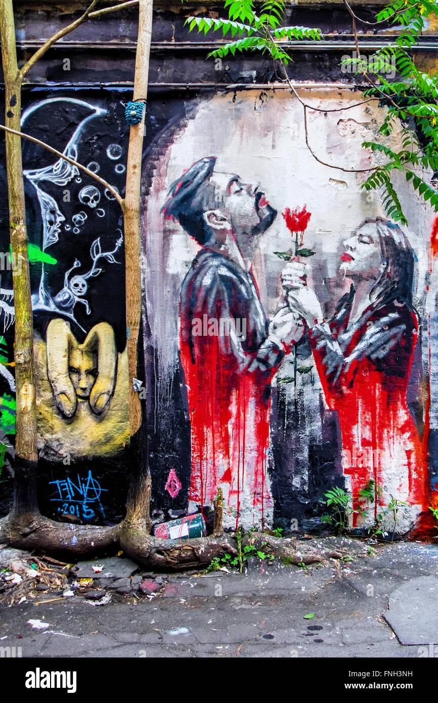 Street art man woman and red rose in inner courtyard of haus schwarzenberg berlin