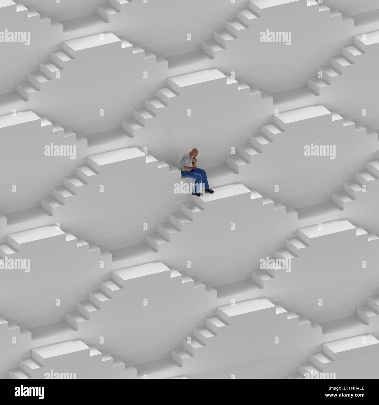 man sitting on the endless stairs - Stock Image