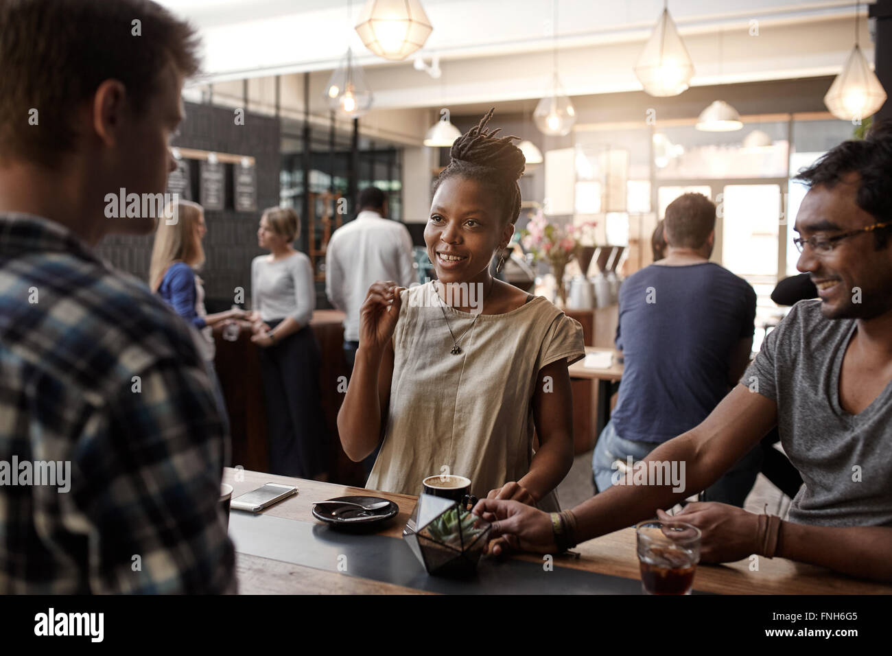 African woman entrepreneur having meeting in a coffee shop - Stock Image