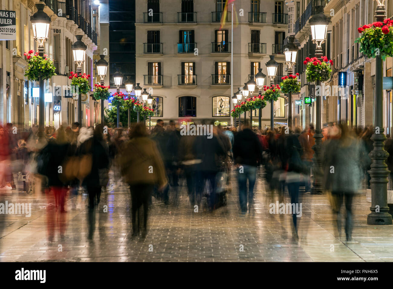 Night view of Calle Marques de Larios pedestrian street, Malaga, Andalusia, Spain - Stock Image
