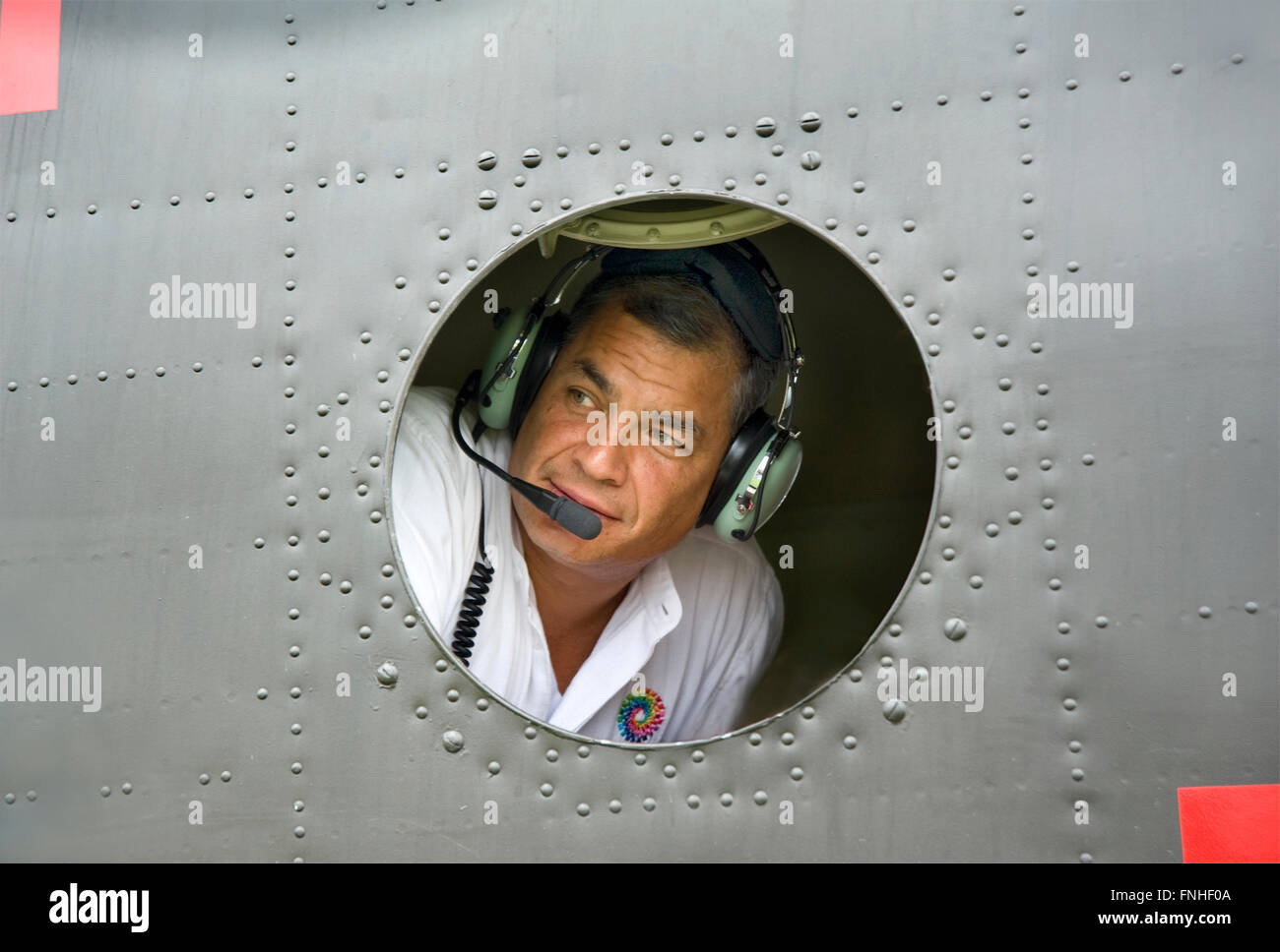 President Correa looks out the window of his helicopter during filming of travel documentary Ecuador: The Royal - Stock Image