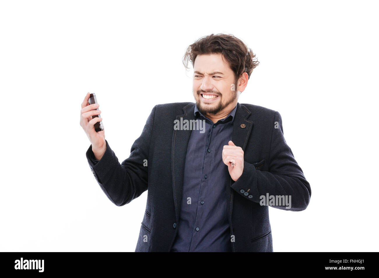 Businessman taking a bad phone call isolated on a white background - Stock Image