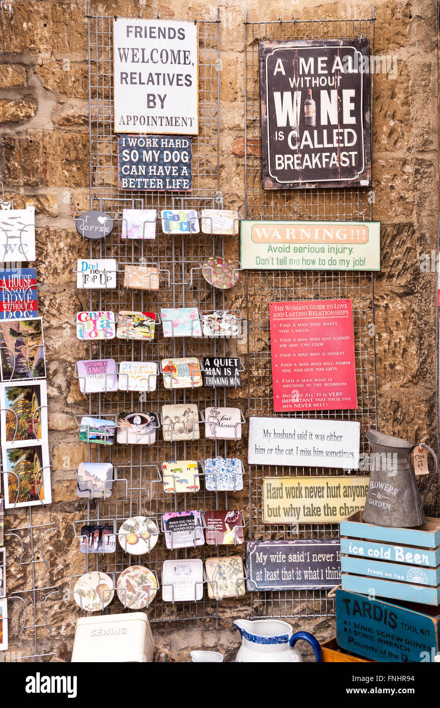 Humorous signs for sale outside a Uk gift shop store - Stock Image