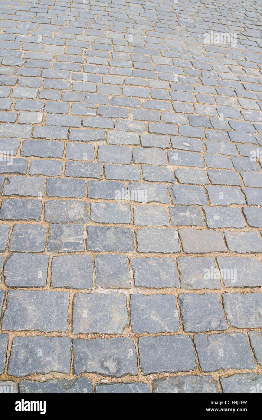 The road is paved with large stone - Stock Image