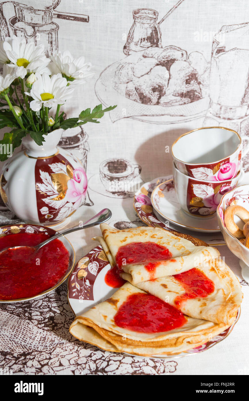 Pancakes with fresh strawberry jam for Breakfast - Stock Image