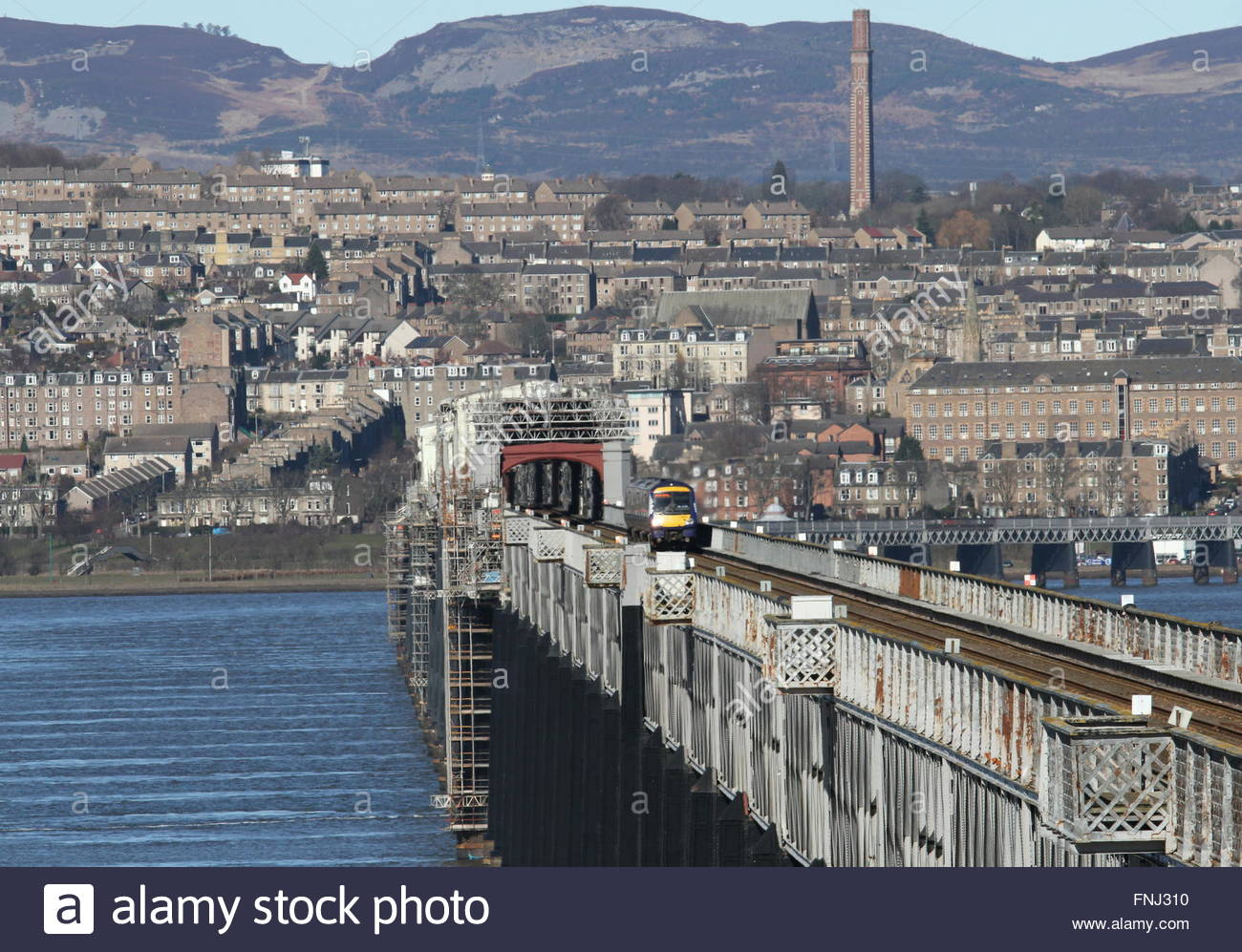 Train crossing Tay Rail Bridge with Cox's Stack Chimney Dundee Scotland  March 2016 - Stock Image