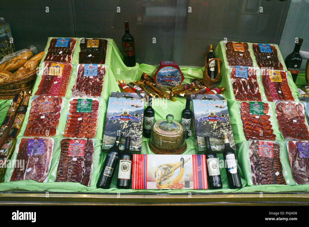 Spanish ham sausage bacon cured meats jamon for sale Butcher's window Chacuterie,  Madrid Spain - Stock Image