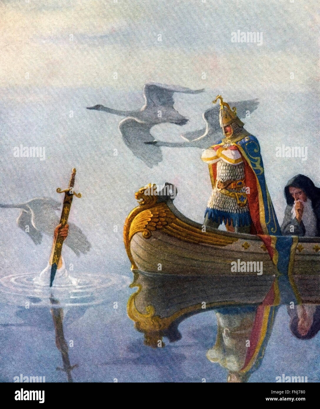 King Arthur and a hand holding the sword Excalibur. An illustration from 'The Boy's King Arthur: Sir Thomas - Stock Image