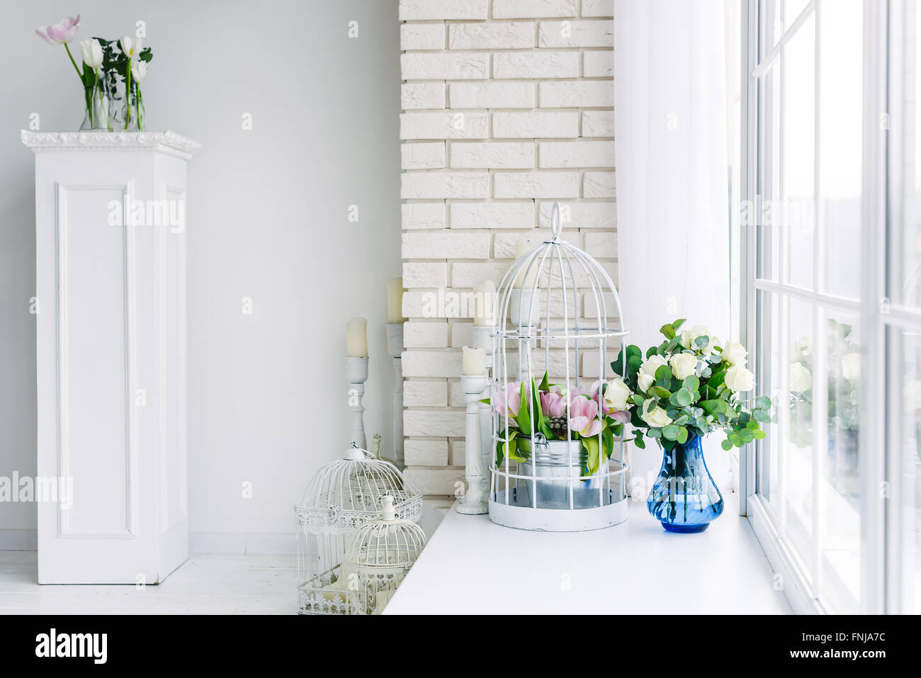 Flowers on the windowsill in studio - Stock Image