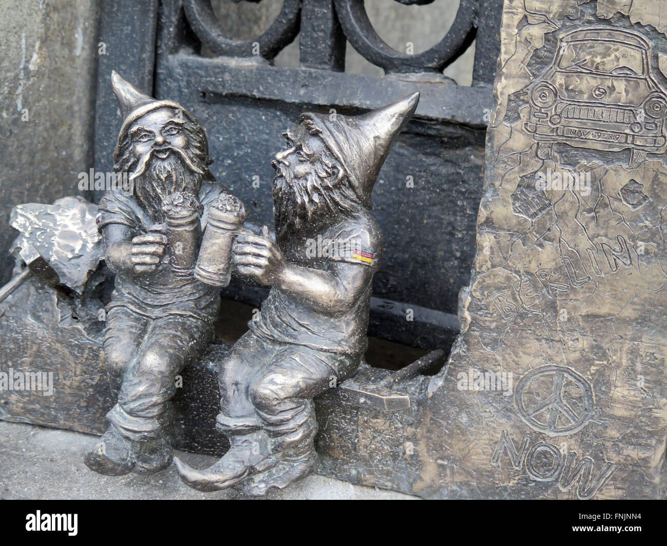 A pair of dwarves pictured in front of the consulate general in Wroclaw, Poland, photographed in January 2016. Once - Stock Image