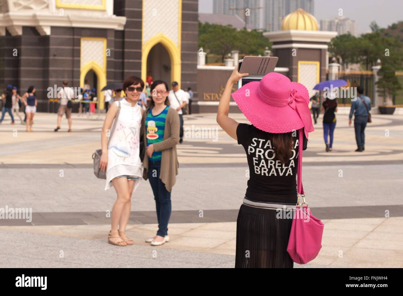 Tourists are taking pictures in front of the National Palace in Kuala Lumpur, Malaysia, on 19 October 2014. Photo: - Stock Image