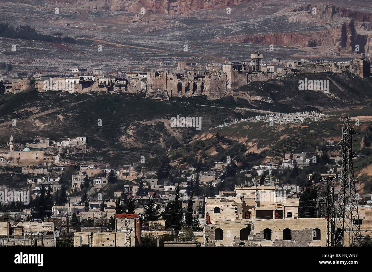 HAMA PROVINCE, SYRIA. MARCH 16, 2016. A panoramic view of the town of Apamea (Afamiya) with a distant view of Qalaat - Stock Image